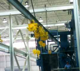 Hoists Approaching Shot Blasting Chamber